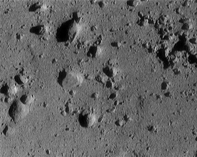 Eros asteroid from approximately 250 meters altitude (area in image is roughly 12 meters across). This image was taken during NEAR's descent to the surface of the asteroid.