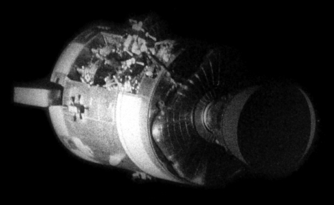 The damaged Apollo 13 Service Module as seen from the Command Module after separation shortly before the Apollo 13 Crew re-entered the Earth's atmosphere. As can be seen, the explosion caused severe damage, ripping open the Service Module.