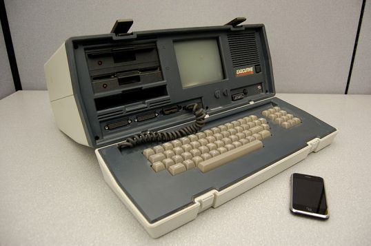 The Osbourne Executive weighed in at 28 & 3/4 pounds of lap crushing power. Compare the size of the executive with the iPhone sitting next to it. The iPhone has hundreds (thousands?) of times the computing power and weighs 4.8 ounces.