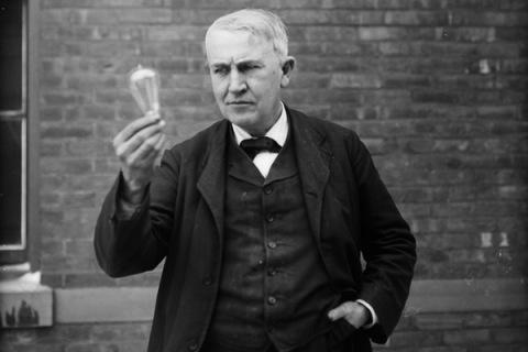 Thomas Alva Edison Holding a Lightbulb