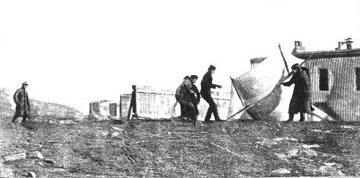 "Marconi watches as associates are raising the kite (a ""Levitor"" by B.F.S. Baden-Powell) used to lift an antenna"
