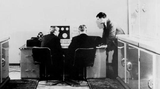 Alan Turing with two colleagues and a Ferranti computer in January 1951. Turing had previously been involved with the construction of both the Colossus, the electronic computer built at Bletchley Park during WW2, and, later, the Automatic Computing Engine. (SSPL/Getty Images)