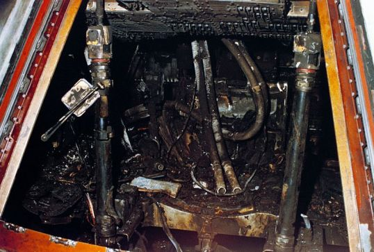 Close-up view of the interior of the Command Module shows the effects of the intense heat of the flash fire
