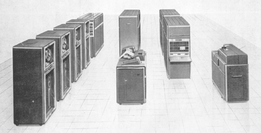 "Here is the ""Gamers"" HOT setup:  Left to right: four Type 727 Magnetic Tape Units, a Type 652 Control Unit, Type 407 Accounting Machine (foreground), Type 653 Auxilliary Unit (high-speed storage, back), Type 650 Console Unit (foreground), Type 655 Power Unit (back), and a Type 533 Read-Punch Unit."