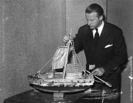 "Norwegian anthropologist Thor Heyerdahl with a model of the balsa raft ""Kon-Tiki"""