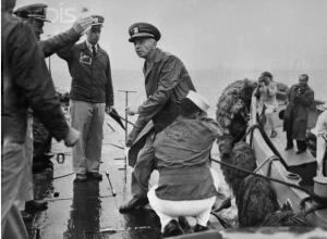 Rickover steps aboard Nautilus at NY harbor