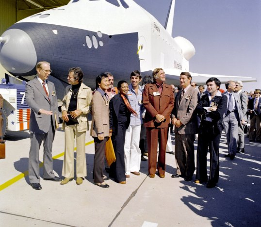 "Star Trek creator Gene Roddenberry, and most of the original series cast attended the shuttle's rollout ceremony in 1976. From left to right: James Fletcher, NASA administrator; DeForest Kelley, Dr. ""Bones"" McCoy; George Takei, Mr. Sulu; James Doohan, Chief Engineer ""Scotty""; Nichelle Nichols, Lt. Uhura; Leonard Nimoy, Mr. Spock, Gene Roddenberry, Star Trek's creator; George Low, NASA deputy administrator; and Walter Koenig, Mr. Chekov. (Credit: NASA)"