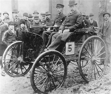 Winner of America's first motor vehicle race Frank Duryea at the left at the tiller, and umpire Arthur W. White of Toronto beside him