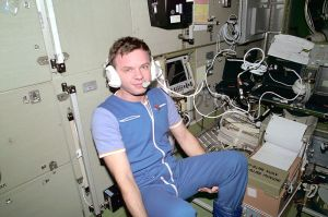 Cosmonaut Yuri P. Gidzenko,, communicates with ground controllers onboard the Zvezda Service Module