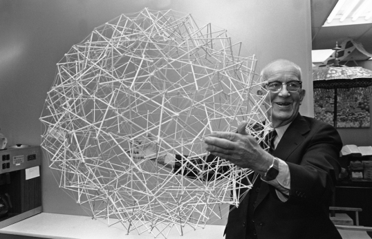 "In this April 18 1979 photo, R. Buckminster Fuller holds up one of his inventions, a tensegrity sphere. The structure, made of rods and cables, was proposed as the basis for floating habitats known as Spherical Tensegrity Atmospheric Research Stations (or ""STARS""). Fuller envisioned giant versions of the structure that were so light and strong that when they were filled with hot air, they'd float above the Earth, supporting stations up to a mile in diameter."