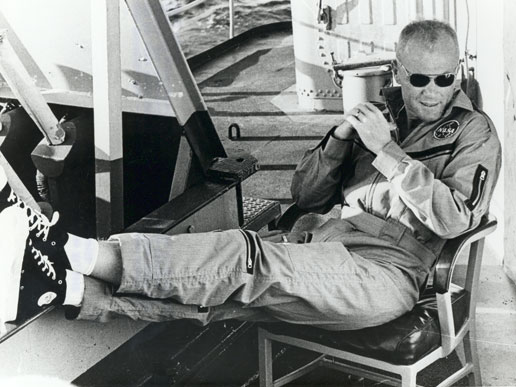 Astronaut John Glenn relaxes aboard the USS Noa after being recovered from the Atlantic near Grand Turk Island after his historic Mercury flight