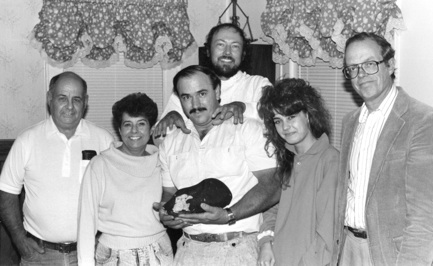 Michelle Knapp (second from right) with her family, along with the original purchasers of the Peekskill meteorite: Dr. Jim Schwade (far right), Marlin Cilz (center), and Ray Myer (center rear).