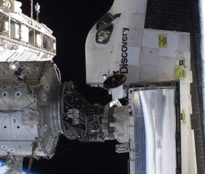 Space_Shuttle_docked_to_station_-_cropped_and_rotated