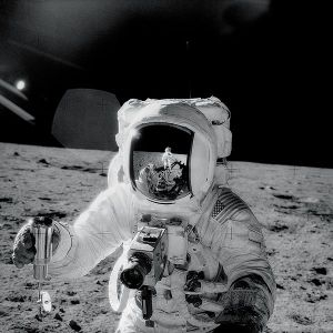 Alan Bean pictured by Pete Conrad (reflected in Bean's helmet)