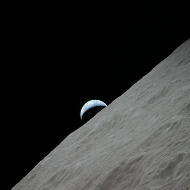 View of the waning crescent Earth rising above the lunar horizon