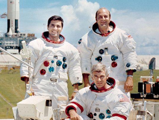 Commander, Eugene A. Cernan (seated), Command Module pilot Ronald E. Evans (standing on right), and Lunar Module pilot, Harrison H. Schmitt