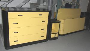 "Three piece bedroom set was designed for the Simmons Company, introduced in 1932 and exhibited at the 1933 Worlds Fair in Chicago. The set is in ""exhibition yellow"" and black enamel on steel."