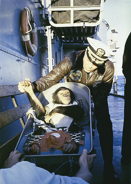 "The famous ""hand shake"" welcome. Chimpanzee Ham is greeted by recovery ship Commander after his flight on the Mercury"