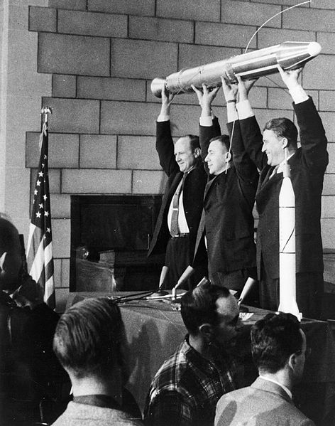 William Hayward Pickering, James Van Allen, and Wernher von Braun display a full-scale model of Explorer 1 at a crowded news conference in Washington, DC after confirmation the satellite was in orbit.