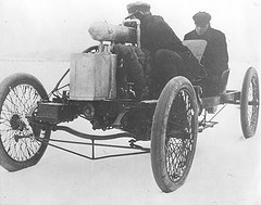 "Henry Ford in back and Ed 'Spider' Huff driving the ""999"", Lake St. Clair, Michigan, January 1904"